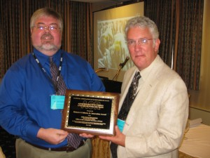 Jon Davidson (AR, left) receives Colborn Award from Dennis Stevenson (ID, right).